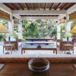 Living area of the Pita Linggar 3 bedroom home with modern furniture and open aspect outlook over the Bali jungle