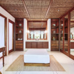 Master bedroom at the Pita Linggar 3 bedroom home on the Como Shambhala estate with wooden features